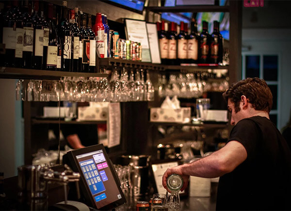 Bar working with POS terminal nearby
